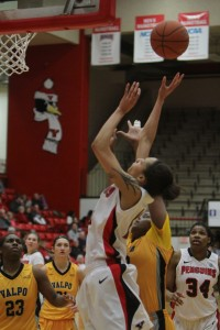 Youngstown State's Karen Flagg (14) puts up a jump shot while being defended by Valparaiso's Sharon Karungi (33) during the first half of Saturday afternoon's matchup at the Beeghly Center. Flagg had 14 points during YSU's 84-56 victory over the Crusaders.  Photo by Dustin Livesay  |  The Jambar.