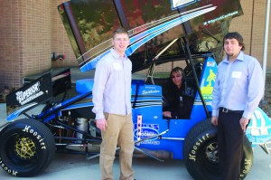 From left to right: James Stiger, Anthony Davis and Brandon Spithaler show off an off-road, winged vehicle they helped design as part of their senior capstone project. Saturday's STEM Showcase featured over 50 student-conducted science projects.