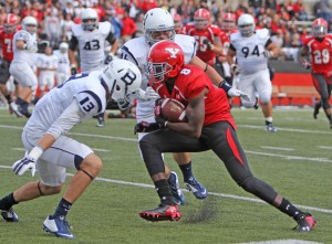 Youngstown State's Jelani Berassa  (8) evades a tackle by Butler's Ryan Kelsey (13) and Jordan Massey (46) on his way to the endzone during the second quarter of Saturday evenings matchup at Stambaugh Stadium. Berassa had six receptions for 167 yards and three touchdowns leading the Penguins to a 44-13 victory over the Bulldogs.  Dustin Livesay  |  The Jambar