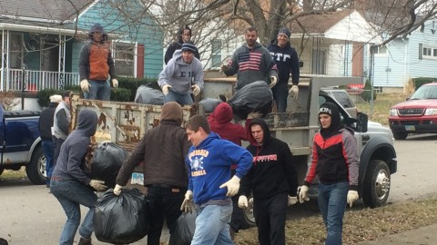 Members of the YSU Chapter of Sigma Tau Gamma help to clean neighborhoods in Youngstown through the Youngstown Neighborhood Development Corporation. Photo courtesy of Brandon O'Neill.
