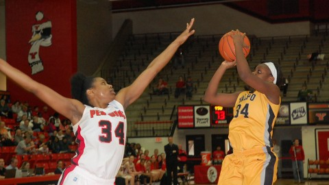 Senior forward Latisha Walker (34) attempts to block Valparaiso forward Jasmyn Walker's shot during the second half of YSU's 80-57 win over the Crusaders on Saturday.