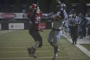 Youngstown State University linebacker Dubem Nwadiogbu (22) deflects a potential touchdown away from a Robert Morris University receiver during overtime.