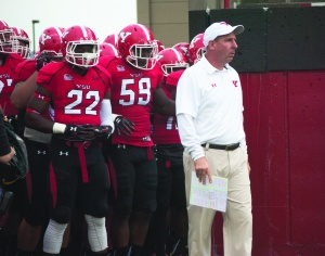 Bo Pelini, head coach of the Youngstown State University football team, picked up his first Missouri Valley Football Conference victory after the Penguins defeated the University of South Dakota 31-3 on Saturday in the Dakota Dome.