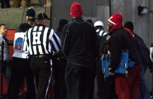 Angry Youngstown State University fans wait in front of the tunnel as the referees from Saturday's game leave the field.