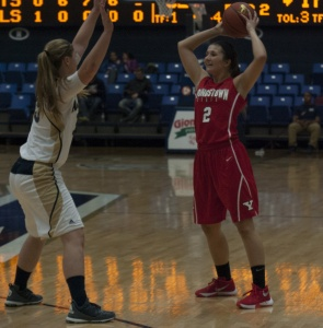 Youngstown State University guard Alison Smolinski looks to pass the ball in Monday night's loss to the University of Akron.