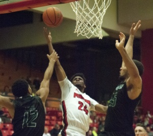 Youngstown State University guard Cameron Morse scores on a layup to extend YSU's lead to 56-48 in the second half.