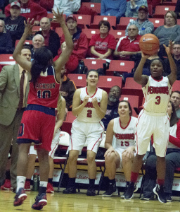 Youngstown State University point guard Indiya Benjamin shoots a 3-pointer to take a 68-65 lead with one minute remaining.