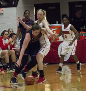 Youngstown State University forward Sarah Cash prevents a University of Illinois at Chicago player from driving to the basket.