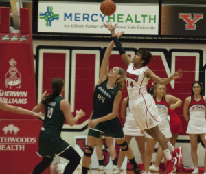 Youngstown State University's Janae Jackson (44) fights with University of Wisconsin Green Bay's Mariah Monke (44) for a rebound.