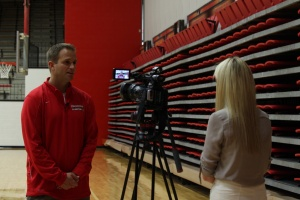 John Barnes, head coach of the Youngstown State University women's basketball team, conducts an interview during media day.