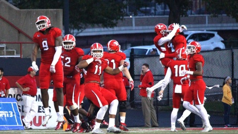The Youngstown State University football team celebrates a win at Stambaugh Stadium.