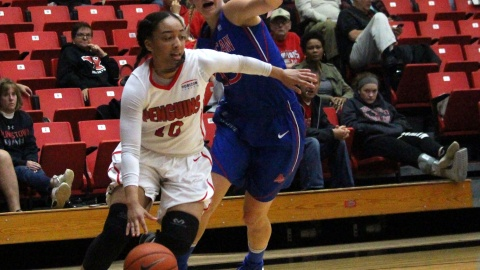 Youngstown State University guard Mailee Jones (10) drives past an American University defender as she drives to the basket.