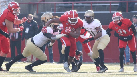 Youngstown State University running back Tevin McCaster breaks a tackle during YSU's 30-23 win over Wofford College in the quarterfinals.