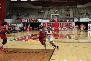 Indiya Benjamin (3) drives to the basket with Brittney Jackson (10) defending.