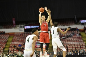 Matt Donlan (0) shoots a 3-pointer over Kenny Carpenter (1) and Anthony Wright (4) in YSU's First Round win.