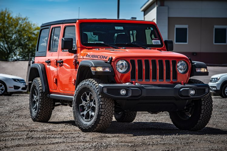 photo-of-red-rubicon-parked-on-dirt-road-2301220
