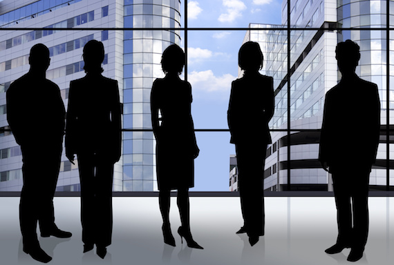 business people in front of an office window