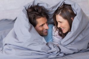 cheerful-couple-in-bed