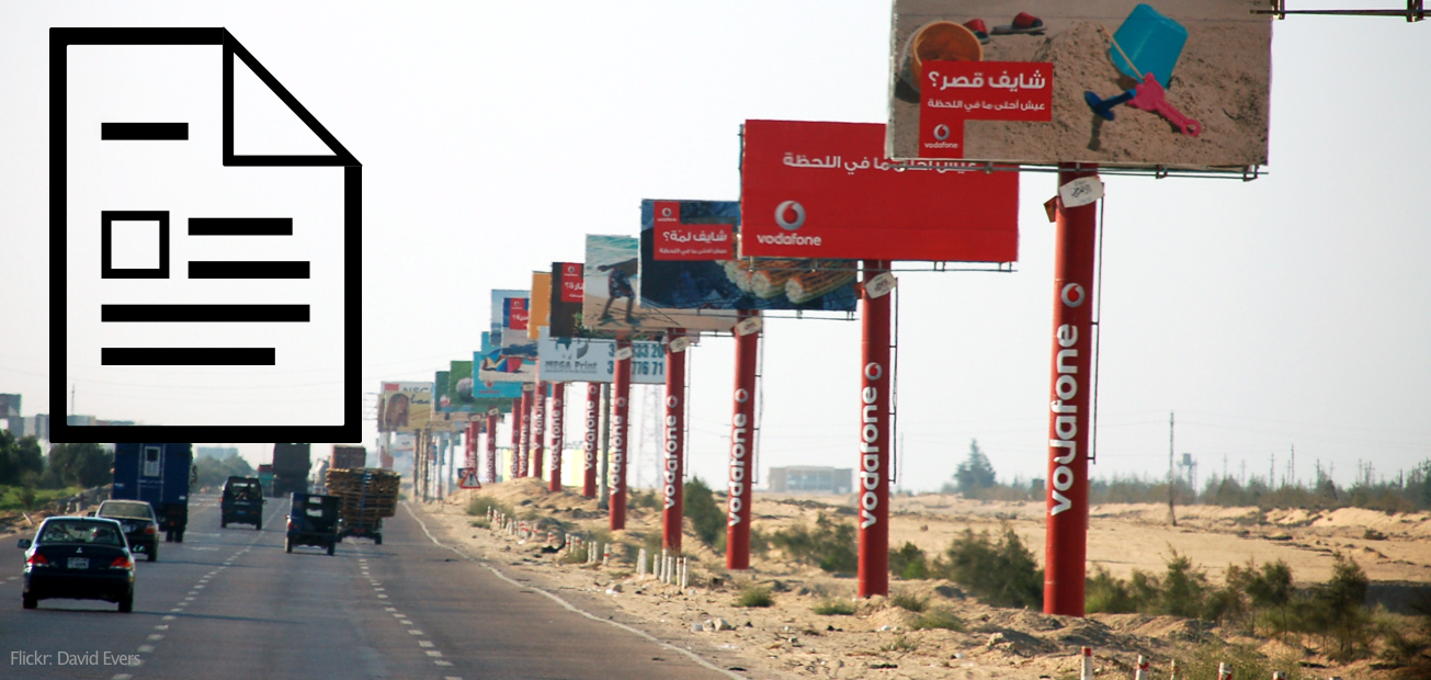 A billboard filled highway with a huge article logo overlaying the image