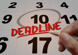 A calendar with a big red deadline on it