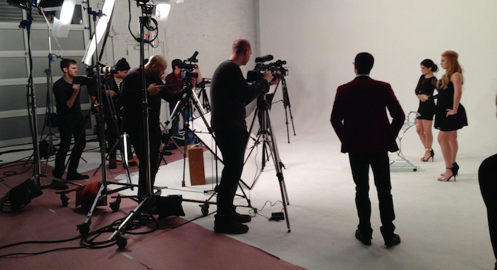 On the set of a large video production - lights, cameras, cast & crew