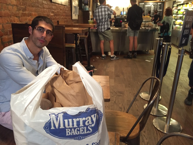 Michael Sorace with bagels in Murray's Bagels in the West Village
