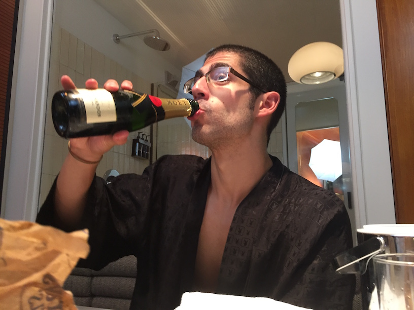 Drinking champagne to celebrate the bagel challenge.