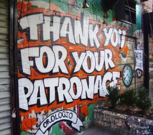 "Spray paint wall art saying, ""Thank you for your patronage."""