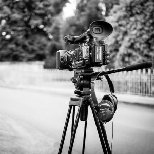 A black & white image of a video camera