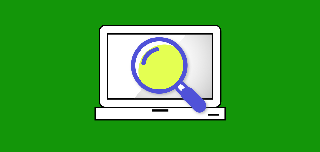 A magnifying glass over a computer
