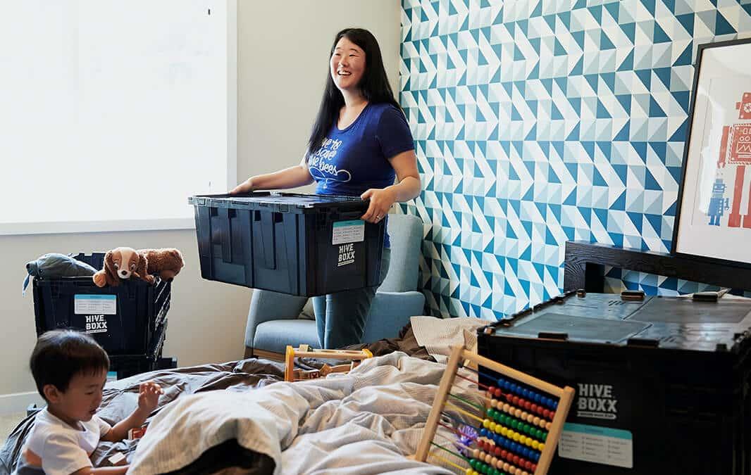 Woman moving a box
