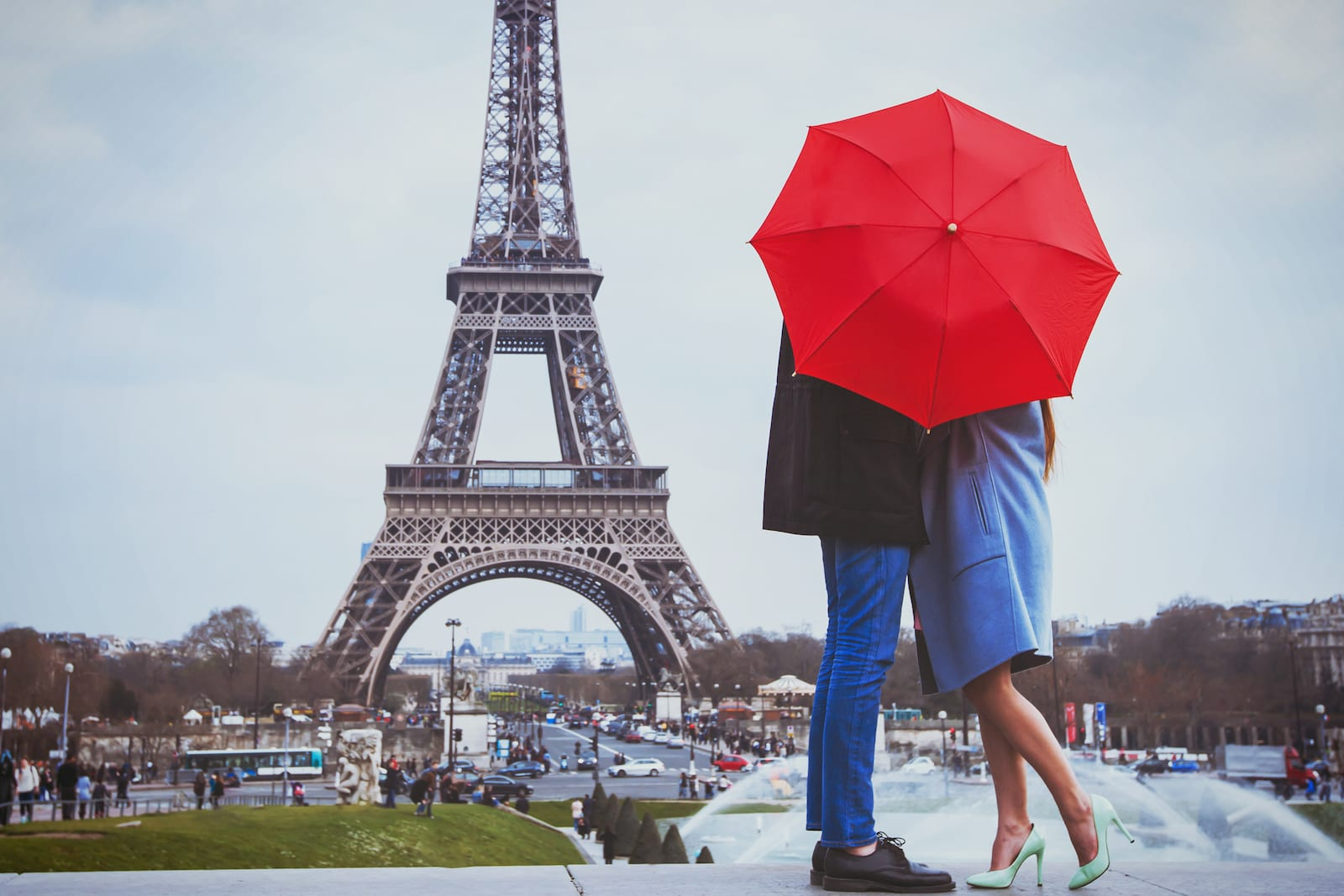 Couple kissing with Eiffel Tower in the background