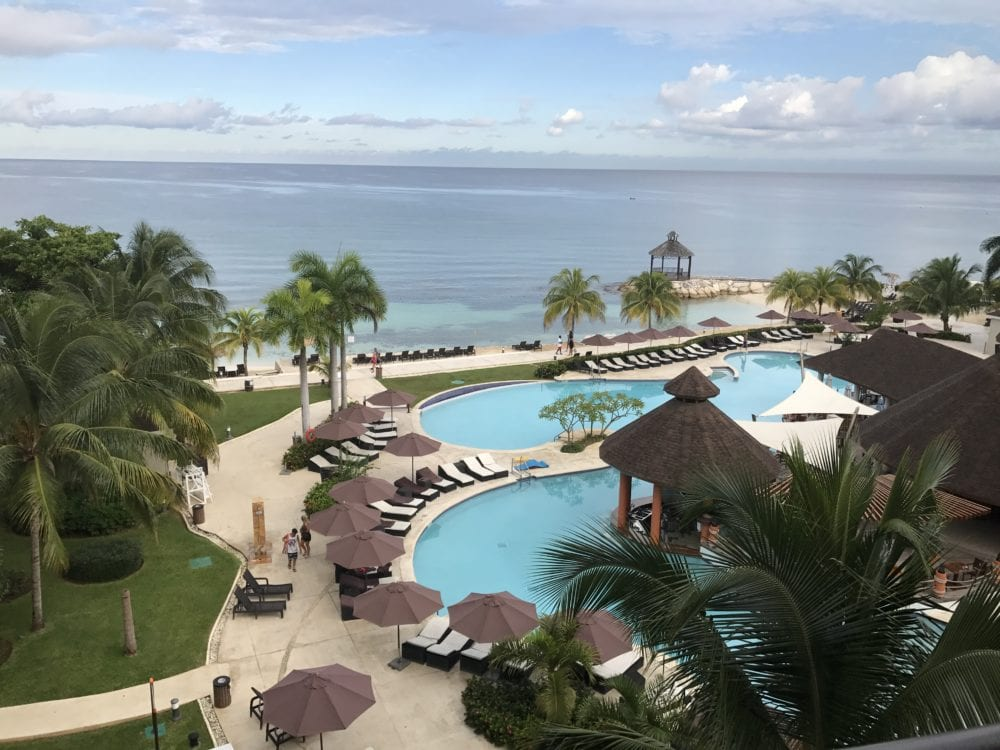 Pool and ocean view at Secrets Wild Orchid