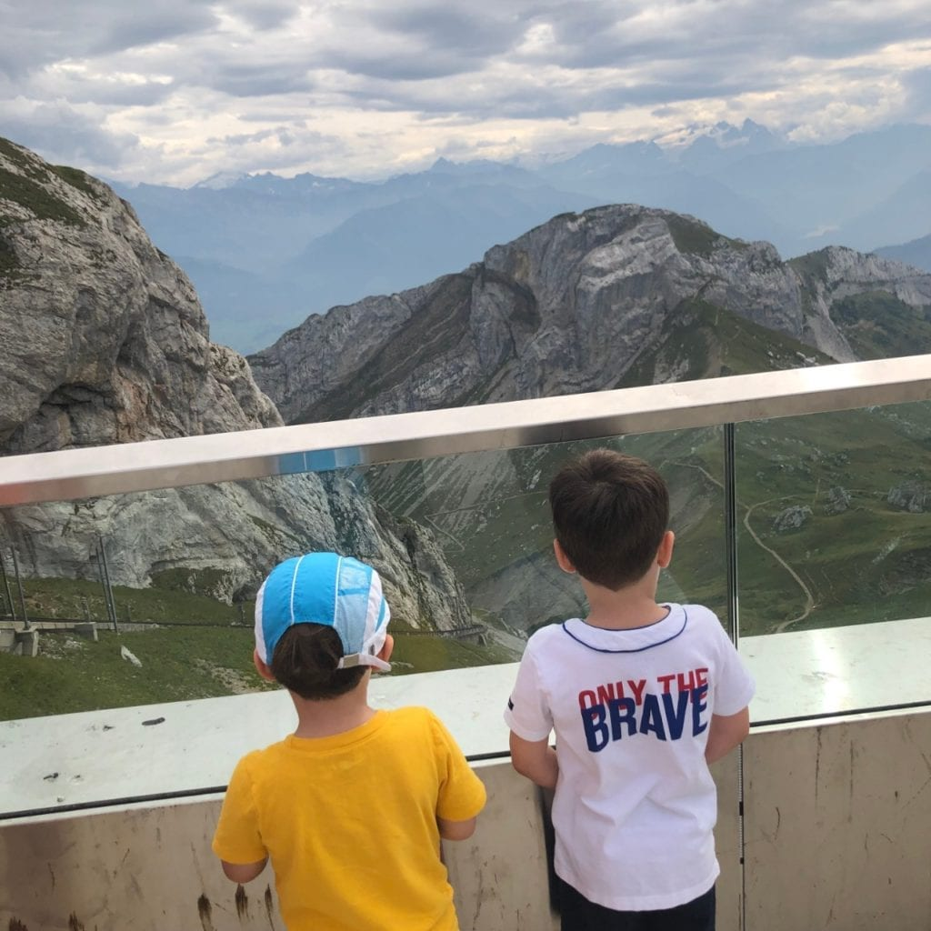 Two boys looking at a mountain in Switzerland, Swiss Alps, Mount Pilatus Lucerne