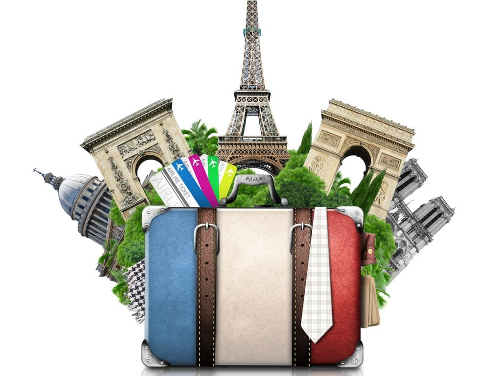 Image of a suitcase with France flag and France landmarks in the background