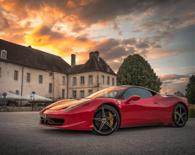 Luxury sports car in front of a fancy house, chateau in Italy, Motor Valley