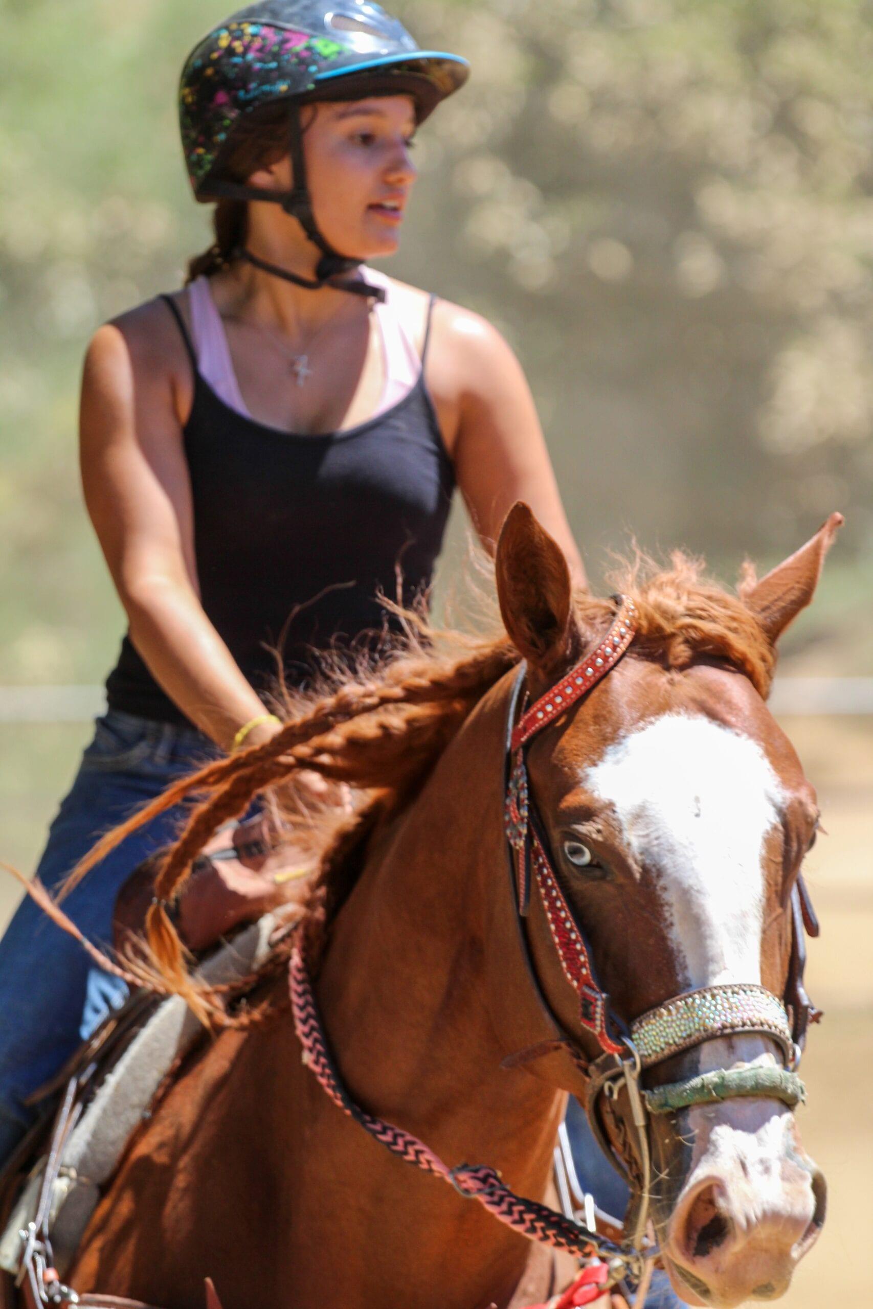 Photo by Christine Benton on Unsplash - Girl on a horse