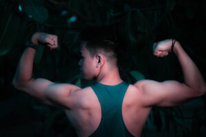 Man in green tank top arm numbness (TOS) & muscles