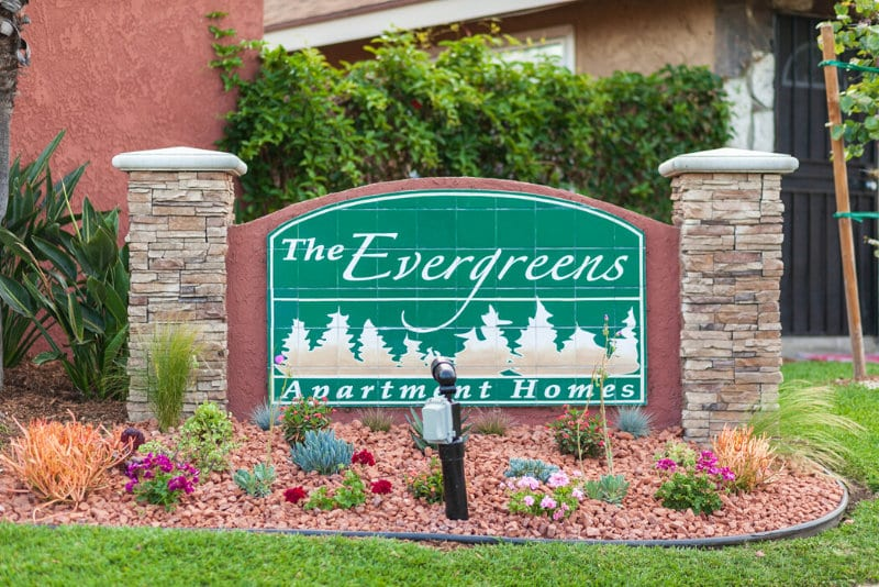 The Evergreens Apartment Homes Sign