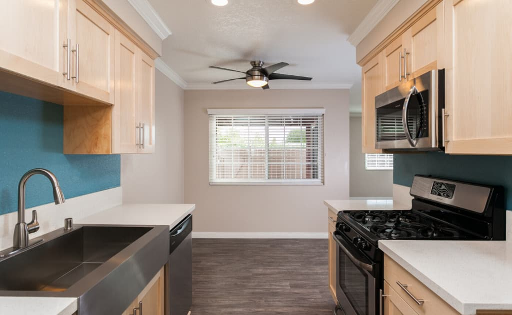Kitchen with white countertops and light wood cabinets