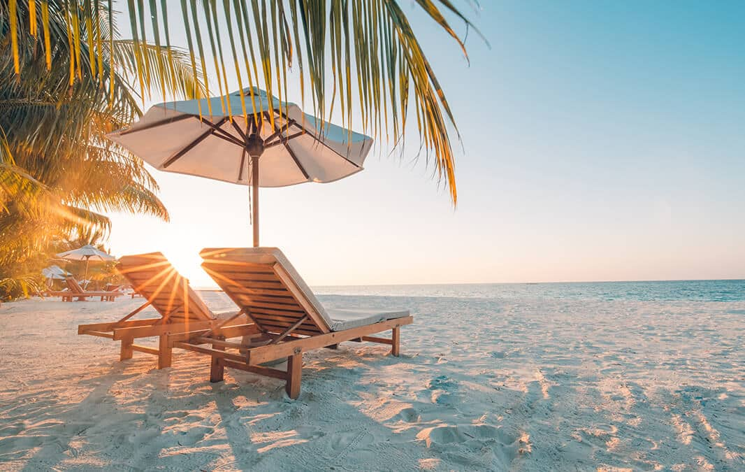Beach Umbrella and chair at the sand