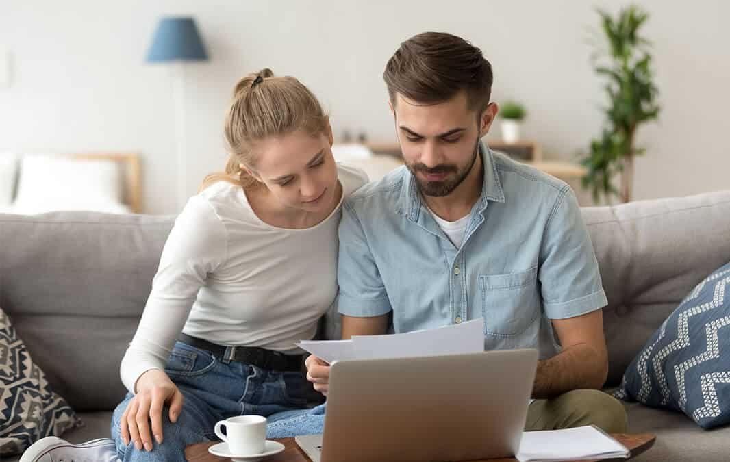 Couple paying apartment online