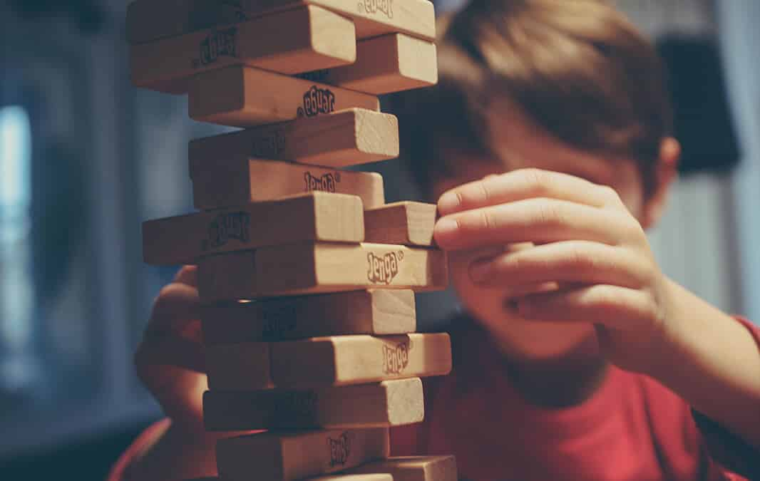 boy in red shirt plays with benga blocks