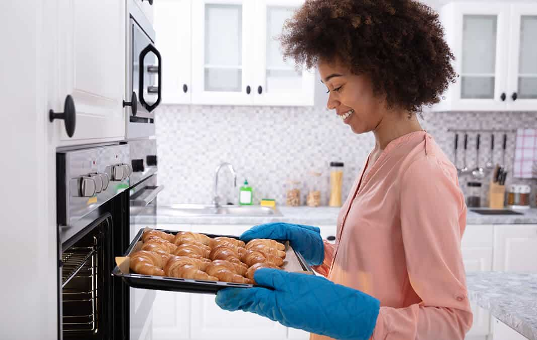 woman baking croissants