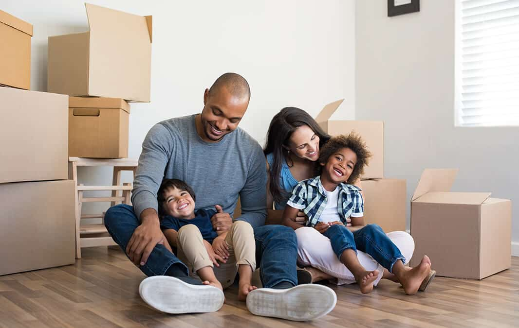 family sitting in new home