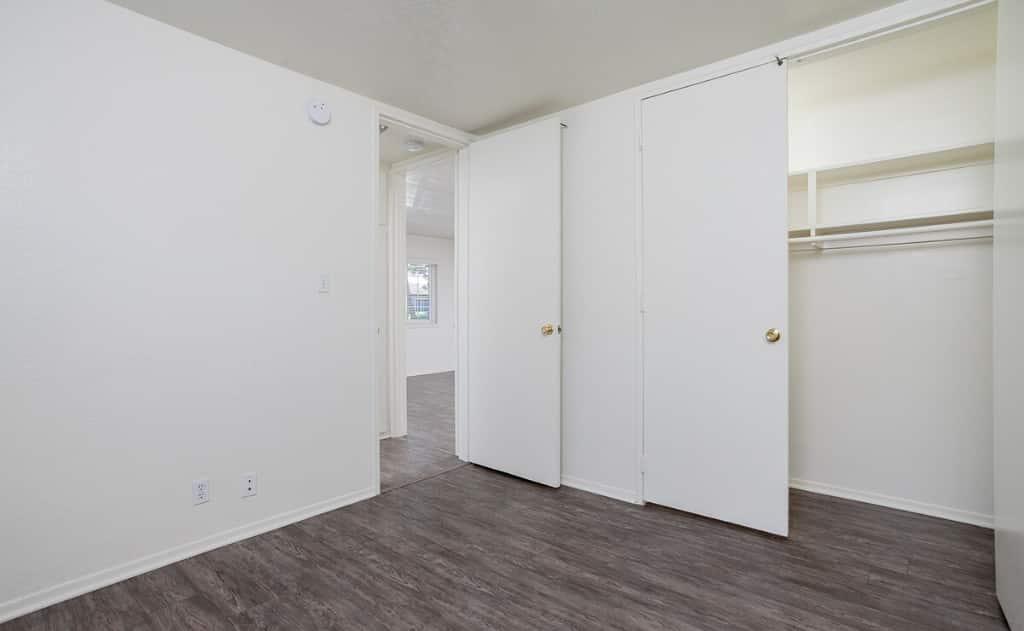Open door to empty walk in closets