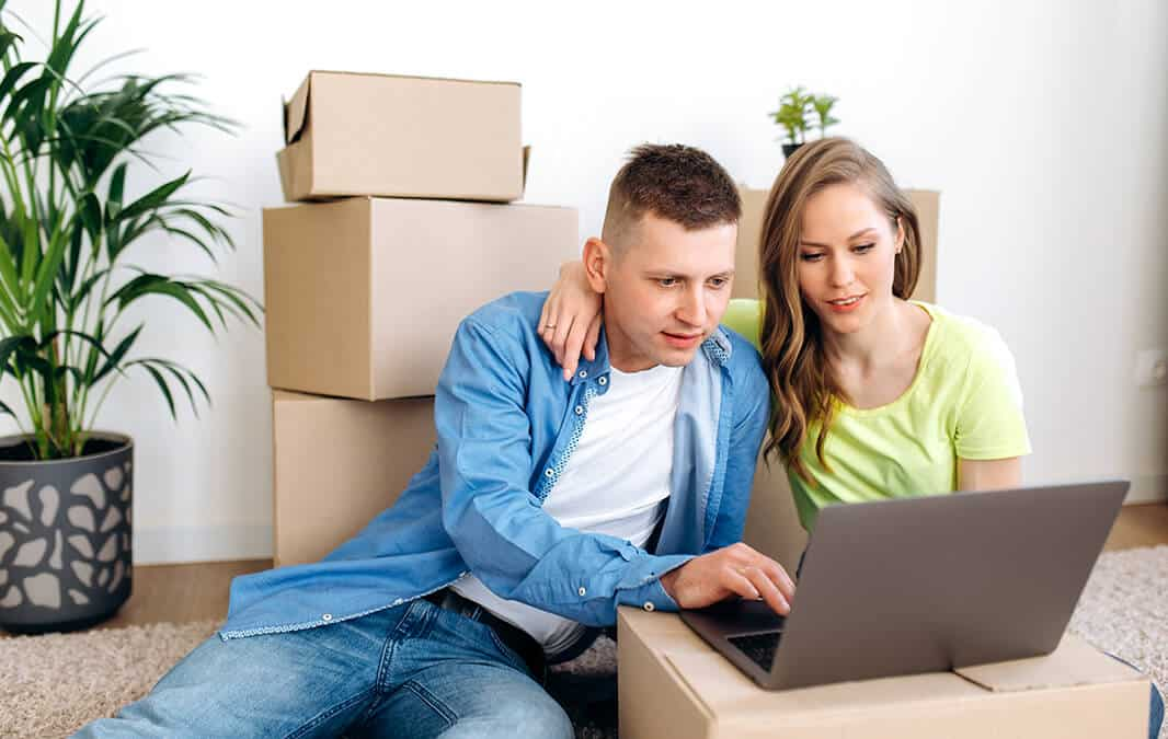 Newly moved couple paying apartment online