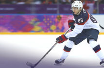 Patrick Kane with the puck during the Men's Ice Hockey Semifinal Playoff ot Sochi Winter Olympics.
