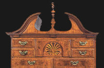 Christie's: Detail of a Queen Anne inlaid walnut and walnut veneered high chest-of-drawers and en suite dressing table, Ipswich, Massachusetts, 1735-1760. © Christie's Images Limited 2018.