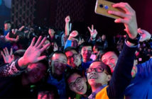 Attendees take a selfie before a press conference announcing the return of the Motorola brand to China, Beijing, Jan. 26, 2015 (AP photo by Ng Han Guan).